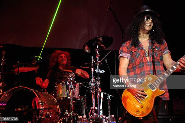 Former Guns N' Roses members Steven Adler and Slash perform at the LAYN Rocks benefit concert for the Los Angeles Youth Network held at the Avalon...