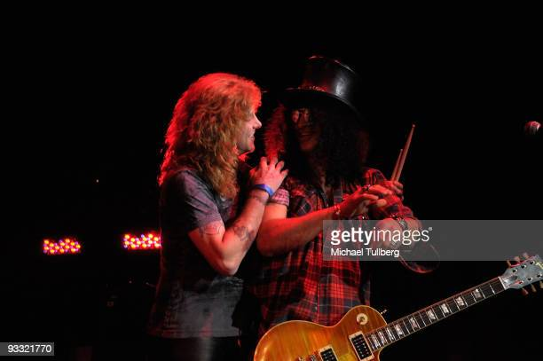 Former Guns N' Roses members Steven Adler and Slash perform at the 'LAYN Rocks' benefit concert for the Los Angeles Youth Network held at the Avalon...