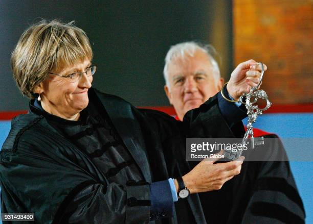 Former Harvard University president Derek Bok looks on Drew Gilpin Faust is presented with the ceremonial keys during her installation ceremony in...