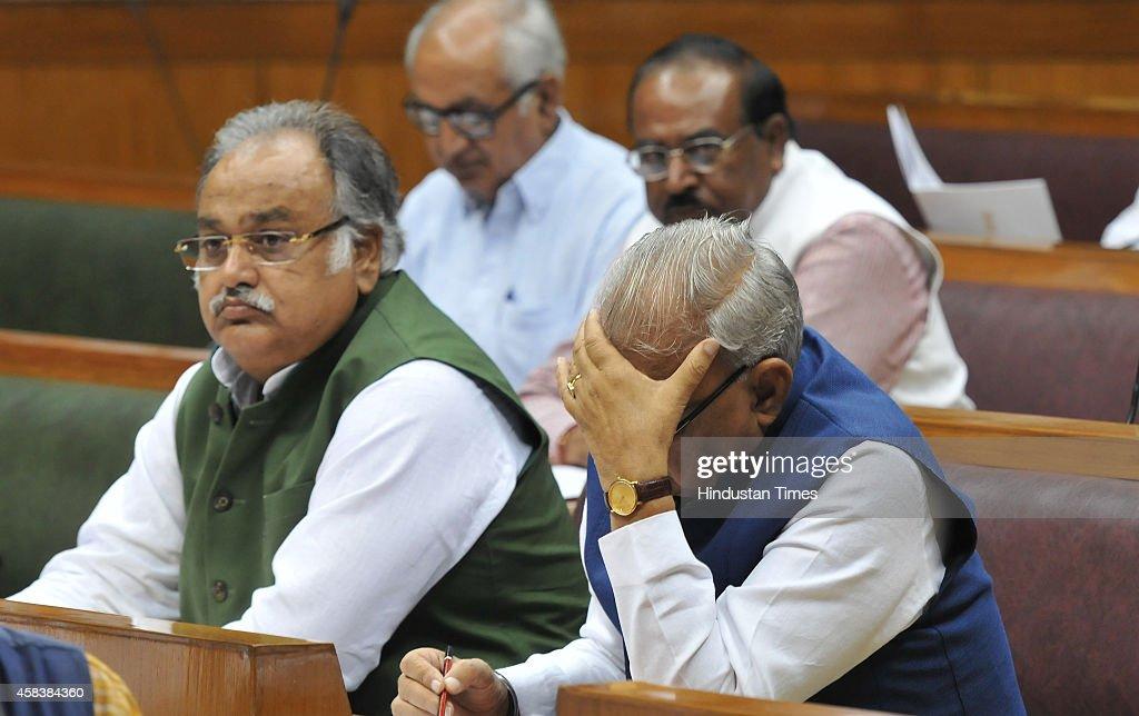 Former Haryana chief minister Bhupinder Singh Hooda with Congress MLA Kuldeep Sharma at Haryana Assembly during second day session on November 4 2014.