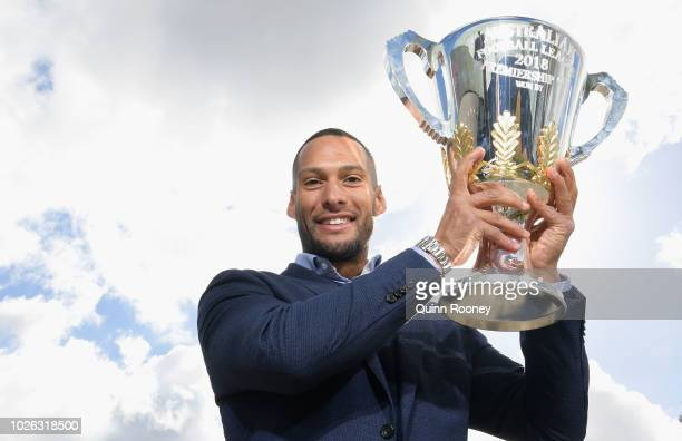 Former Hawks player and Premiership Cup Ambassador Josh Gibson holds the cup during the 2018 Toyota AFL Finals Series Launch at Toyota CHQ Port...