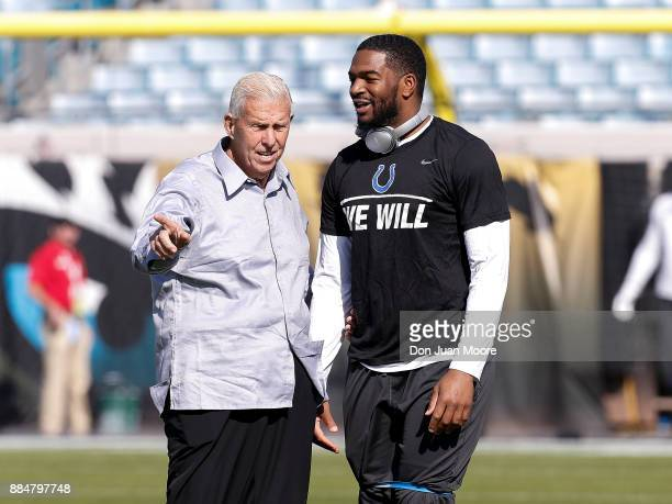 Former Head Coach and Hall of Famer Bill Parcells talks with Quarterback Jacoby Brissett of the Indianapolis Colts before the game against the...