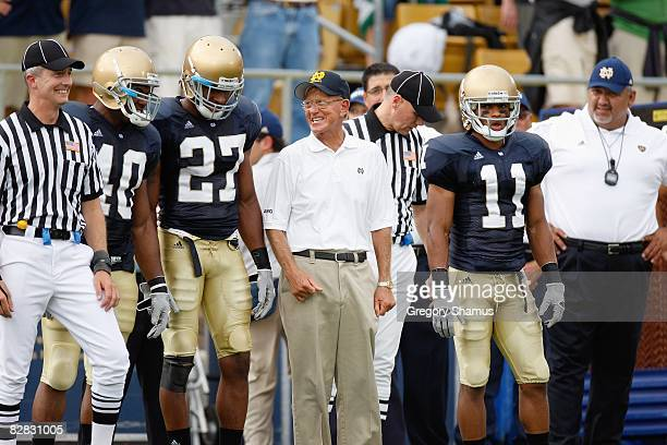 Former head coach Lou Holtz of the Notre Dame Fighting Irish stands with players before the game against the Michigan Wolverines on September 13 2008...