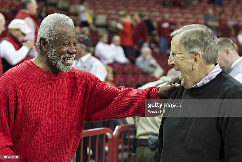 Former Head Coach Nolan Richardson of the Arkansas Razorbacks talks with Brent Musburger before a game against the Tennessee Volunteers at Bud Walton Arena on February 2, 2013 in Fayetteville, Arkansas. The Razorbacks defeated the Volunteers 73-60.