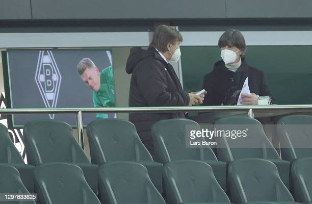 Former head coach of Gladbach, Hans Meyer talks to Joachim Loew, head coach the the German national football team before the Bundesliga match between...