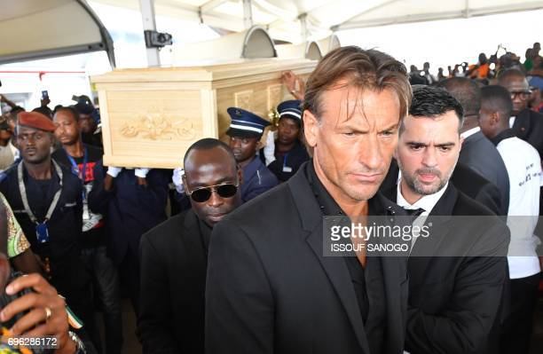 Former head coach of Ivory Coast national football team and current head coach of Morocco's national football team France's Herve Renard looks on as...