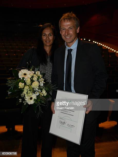 Former head coach of the German National and current head coach of the US Soccer National Team Juergen Klinsmann and his wife Debbie Klinsmann pose...
