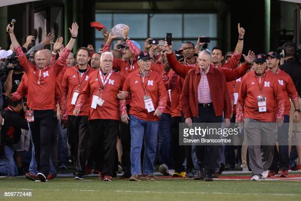 Former head coach Tom Osborne of the Nebraska Cornhuskers leads the 1997 team on the field before the game between the Nebraska Cornhuskers and the...