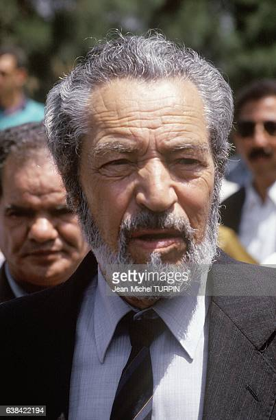 Former head of FLN Mohamed Cherif Messaadia at the funeral of Slimane Amirat and tribute to Mohamed Boudiaf in Algiers Algeria on July 5 1992