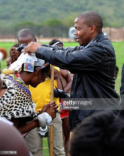 Former head of Lembede Investment Holdings Lonwabo Sambudla stitches money to his bridetobe President Jacob Zuma's daughter Duduzile Zuma at her...