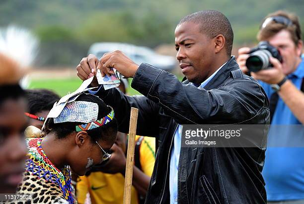 Former head of Lembede Investment Holdings Lonwabo Sambudla stitches money to his bridetobe President Jacob Zuma's daughter Duduzile Zuma at her...