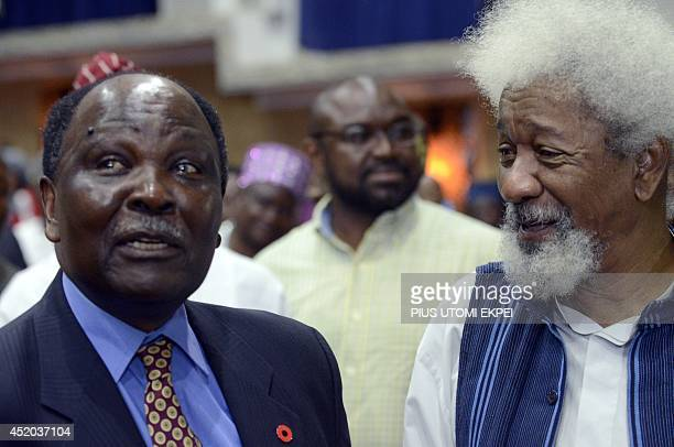 Former Head of State General Yakubu Gowon discusses with literary icon Professor Wole Soyinka during a lecture to celebrate Soyinka's 80th birthday...