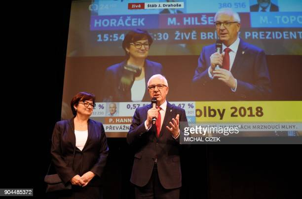 Former head of the Czech Academy of Sciences and candidate for the presidential election Jiri Drahos delivers a speech next to his wife Eva at his...