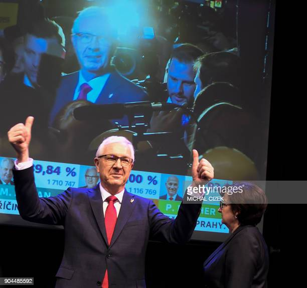 Former head of the Czech Academy of Sciences and candidate for the presidential election Jiri Drahos gestures next to his wife Eva at his election...