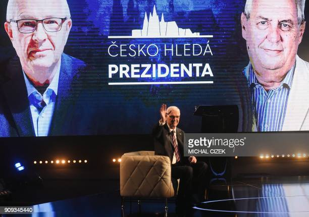 Former head of the Czech Academy of Sciences and candidate for the presidential election Jiri Drahos waves during the presidential debate with Czech...