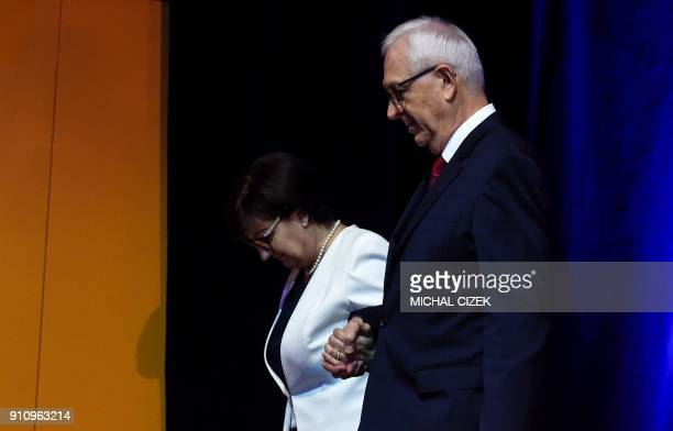 Former head of the Czech Academy of Sciences and presidential candidate Jiri Drahos and his wife Eva leave after speaking during a meeting with...