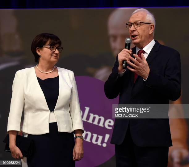 Former head of the Czech Academy of Sciences and presidential candidate Jiri Drahos addresses supporters next to his wife Eva during a meeting at his...