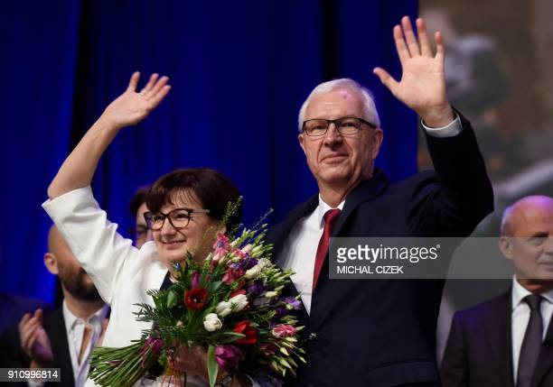 Former head of the Czech Academy of Sciences and presidential candidate Jiri Drahos and his wife Eva wave to supporters during a meeting at his...