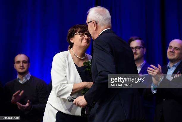 Former head of the Czech Academy of Sciences and presidential candidate Jiri Drahos kisses his wife Eva during a meeting at his campaign headquarters...