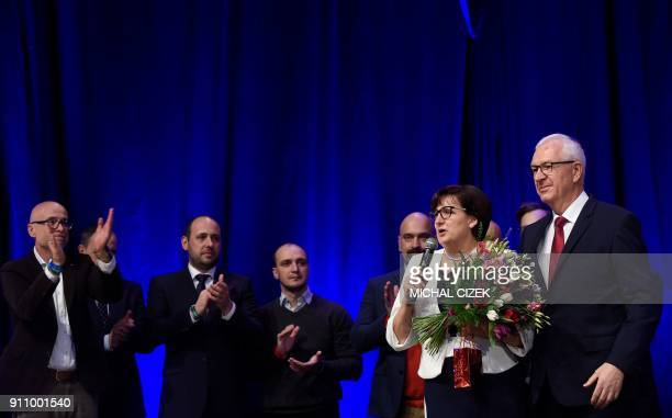 Former head of the Czech Academy of Sciences and presidential candidate Jiri Drahos is pictured on stage beside his wife Eva and his election team...