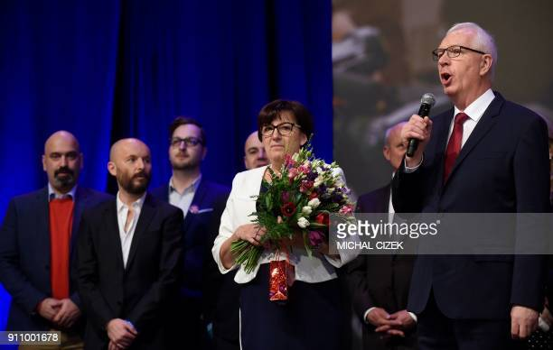 Former head of the Czech Academy of Sciences and presidential candidate Jiri Drahos speaks on stage beside his wife Eva and his election team during...