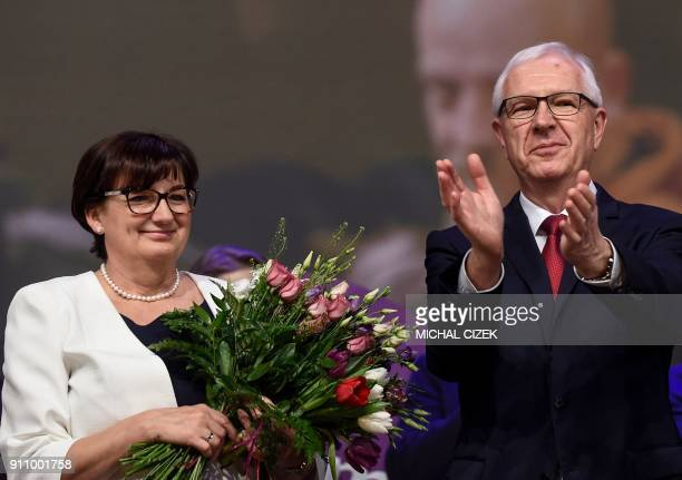 Former head of the Czech Academy of Sciences and presidential candidate Jiri Drahos applauds on stage beside his wife Eva during a meeting with...