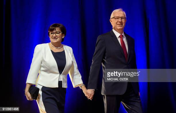 Former head of the Czech Academy of Sciences Jiri Drahos and his wife Eva arrive on the stage to greet their supporters at his campaign headquarters...