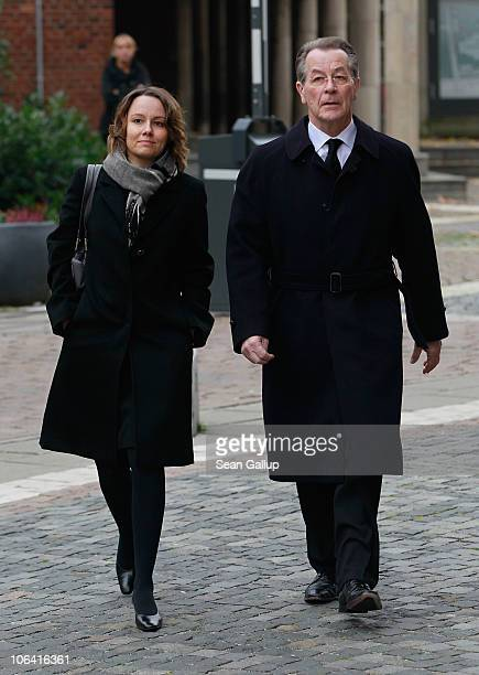 Former head of the German Social Democrats Franz Muentefering and his wife Michelle Schumann arrive for the memorial service for Loki Schmidt wife of...