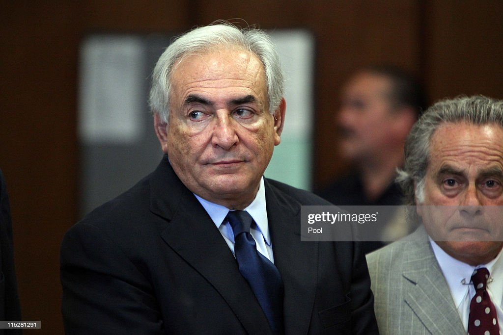Former head of the International Monetary Fund (IMF) Dominique Strauss-Kahn (L) appears at an arraignment trial for sexual assault with his lawyer Benjamin Brafman (R) in Manhattan Criminal Court on June 6, 2011 in New York City. Strauss-Kahn who has been on house arrest is plead not guilty on sexual assault charges after allegedly attacking a maid in a New York hotel room.