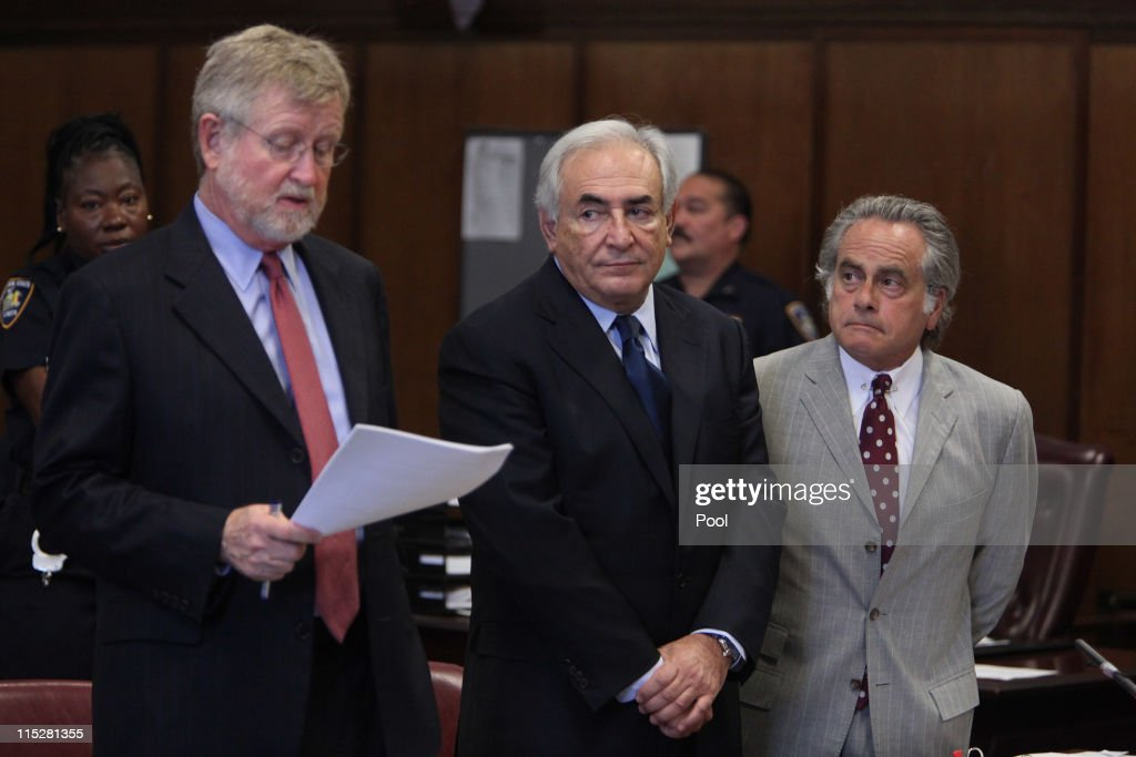 Former head of the International Monetary Fund (IMF) Dominique Strauss-Kahn (C) appears at an arraignment trial for sexual assault with his lawyers William Taylor (L) and Benjamin Brafman (R) in Manhattan Criminal Court on June 6, 2011 in New York City. Strauss-Kahn who has been on house arrest is plead not guilty on sexual assault charges after allegedly attacking a maid in a New York hotel room.