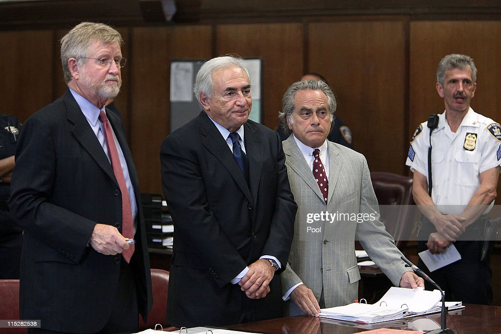 Former head of the International Monetary Fund (IMF) Dominique Strauss-Kahn (C) stands before the judge at an arraignment trial for sexual assault with his lawyers William Taylor (L) and Benjamin Brafman (R) in Manhattan Criminal Court on June 6, 2011 in New York City. Strauss-Kahn who has been on house arrest plead not guilty on sexual assault charges after allegedly attacking a maid in a New York hotel room.