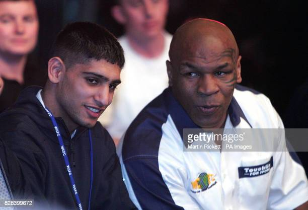 Former heavyweight boxer Mike Tyson and Olympic silver medalist boxer Amir Khan during the World Cage Fighting Championship at the MEN Arena...