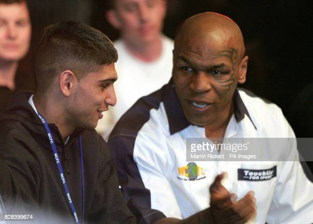 Former heavyweight boxer Mike Tyson speaks with Olympic silver medalist boxer Amir Khan during the World Cage Fighting Championship at the MEN Arena...