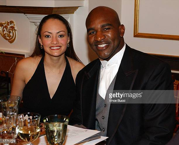 Former heavyweight boxing champion Evander Holyfield and friend Candy Smith attend An Intimate Evening with Evander and Friends a benefit dinner and...