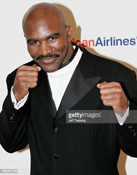 Former heavyweight boxing champion Evander Holyfield poses for photographers upon arriving at Celebrity Fight Night XI at Arizona Biltmore Resort &...