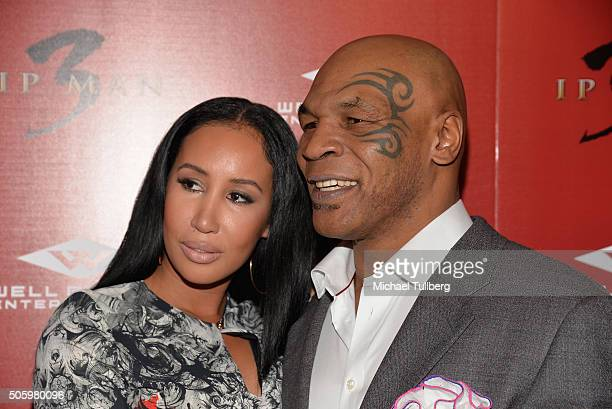 """Former heavyweight boxing champion Mike Tyson and wife Lakiha Spicer attend the premiere of Well Go USA's """"Ip Man 3"""" at Pacific Theatres at The Grove..."""