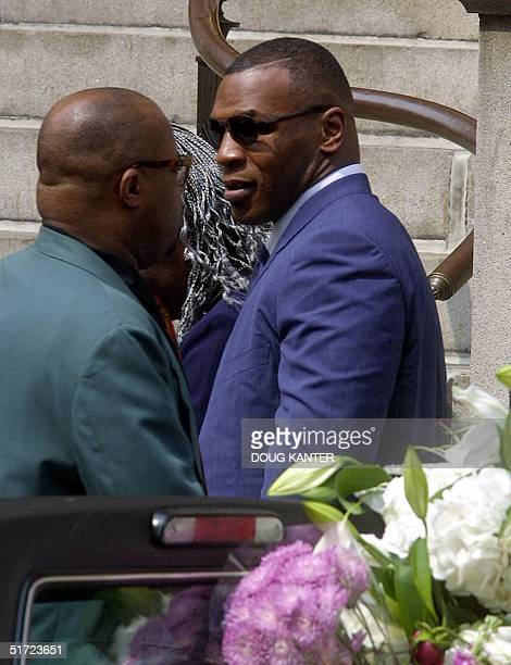 Former heavyweight boxing champion Mike Tyson leaves the funeral of RB star Aaliyah 31 August 2001 at St Ignatius Loyola Church in New York Aaliyah...