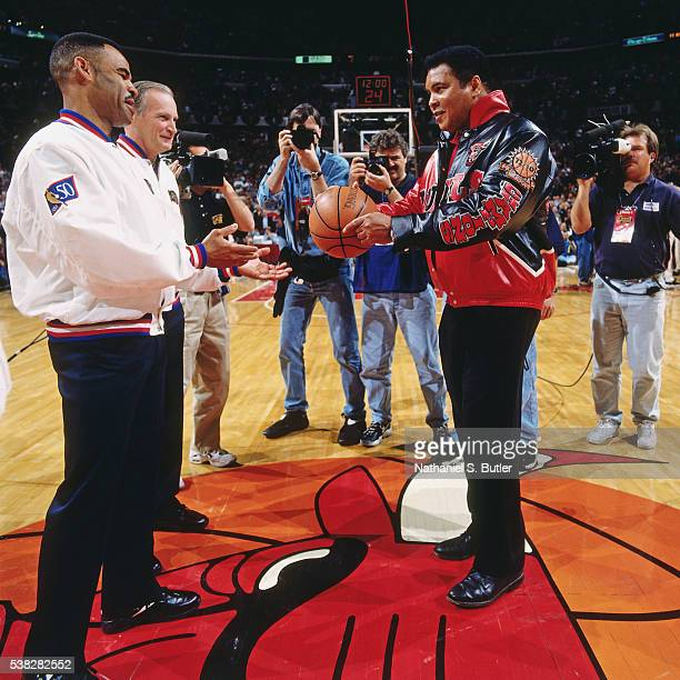 Former heavyweight boxing champion Muhammad Ali presents the game ball during Game One of the 1997 NBA Finals against the Utah Jazz at the United...