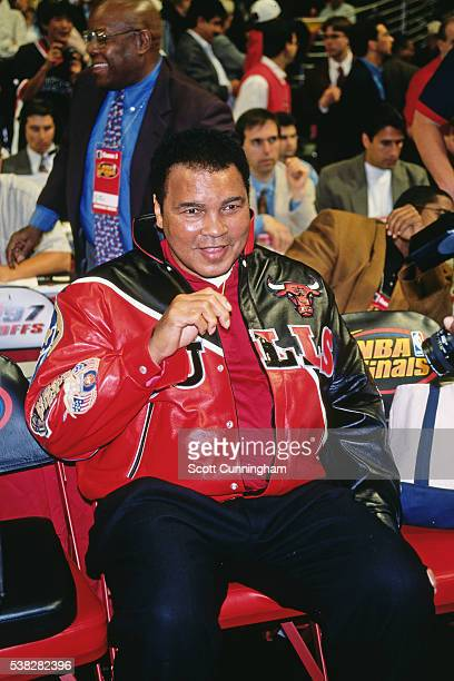 Former heavyweight boxing champion Muhammad Ali sits courtside during Game One of the 1997 NBA Finals between the Chicago Bulls and the Utah Jazz at...