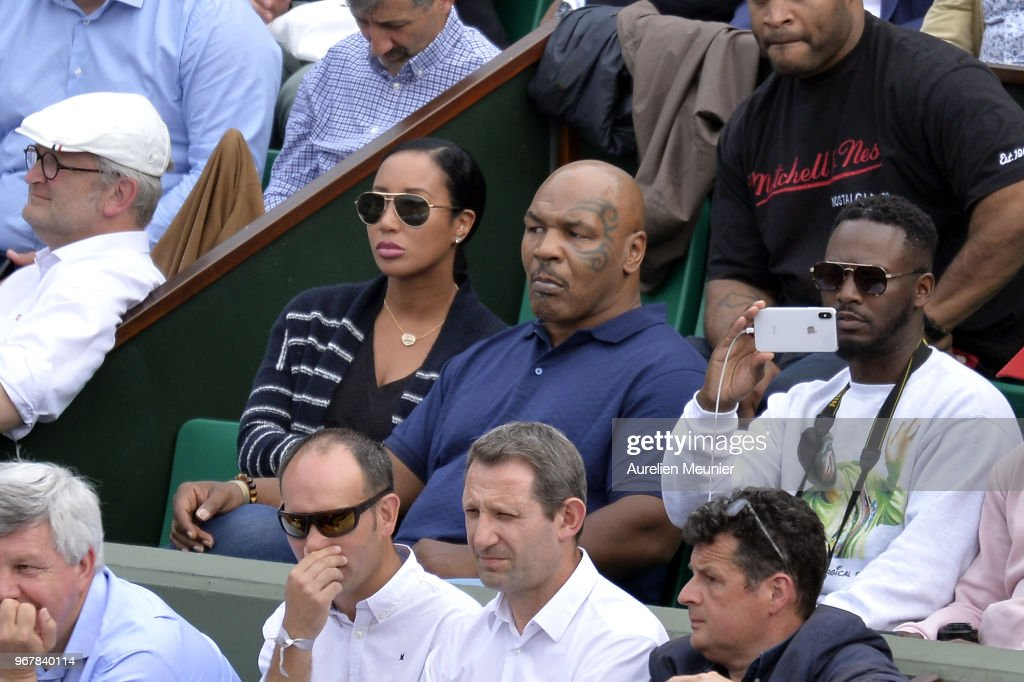 Former heavyweight boxing world champion Mike Tyson (C) and his wife Lakiha Spicer attend the women's singles quaterfinal match between Daria Kasatkina of Russia and Sloane Stephens of The United States of America on day 9 of the 2018 French Open at Roland Garros on June 5, 2018 in Paris, France.