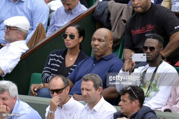 Former heavyweight boxing world champion Mike Tyson and his wife Lakiha Spicer attend the women's singles quaterfinal match between Daria Kasatkina...