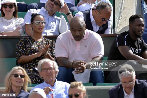 Former heavyweight boxing world champion Mike Tyson and his wife Lakiha Spicer attend the women's singles semifinal match between Simona Halep of...