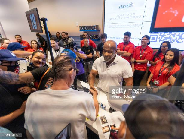 Former heavyweight champion and cannabis entrepreneur Mike Tyson signs autographs and takes photos with fans while promoting his Tyson Ranch brand at...