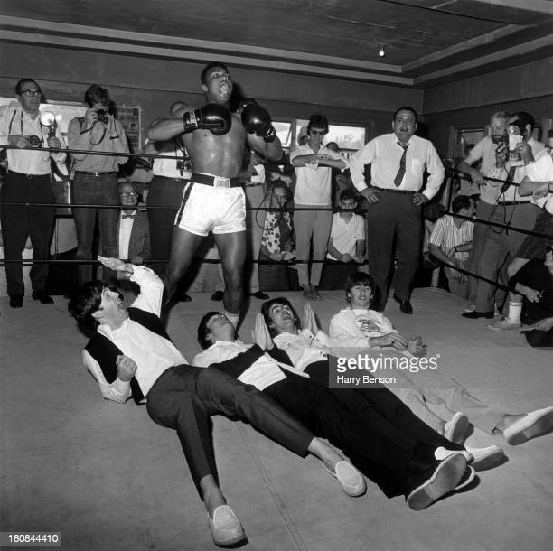 Former heavyweight champion Cassius Clay and the Beatles are photographed at the 5th Street Gym in 1964 in Miami Florida PUBLISHED IN HARRY BENSON'S...