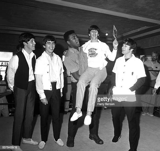 Former heavyweight champion Cassius Clay and the Beatles are photographed at the 5th Street Gym in 1964 in Miami Florida