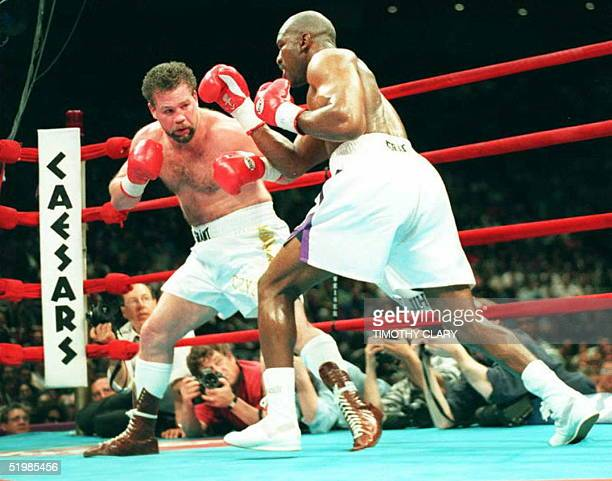 Former Heavyweight Champion Evander Holyfield of the US knocks his opponent compatriot Bobby Czyz into the ropes during their heavyweight fight at...