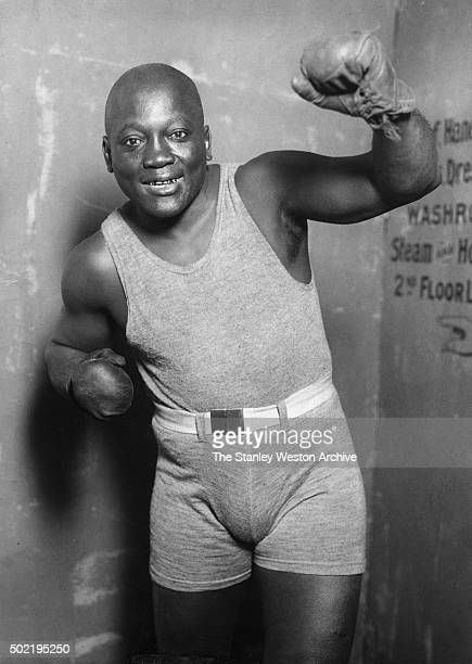 Former heavyweight champion Jack Johnson flashes his famous golden smile as he poses a portrait on April 3 1928 in Topeka Kansas