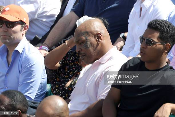 Former heavyweight champion Mike Tyson and his wife Lakiha attend the 2018 French Open Day Twelve at Roland Garros on June 7 2018 in Paris France