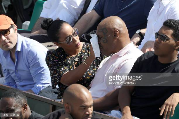 Former heavyweight champion Mike Tyson and his wife Lakiha attend the 2018 French Open - Day Twelve at Roland Garros on June 7, 2018 in Paris, France.