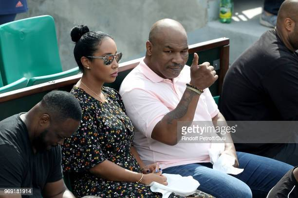 Former heavyweight champion Mike Tyson and his wife Lakiha Spicer attend the 2018 French Open Day Twelve at Roland Garros on June 7 2018 in Paris...